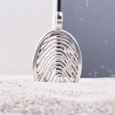zilveren-vingerafdruk-hanger-ovaal_roy-zfph-005_royolz_585_memento-aan-jou